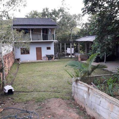 Terreno com casa de 130m² mais sobrado com 96m² e galpão com 70m² em São João do Itaperiu