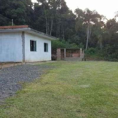 TERRENO COM CASA DE ALVENARIA - NA CIDADE DE AURORA